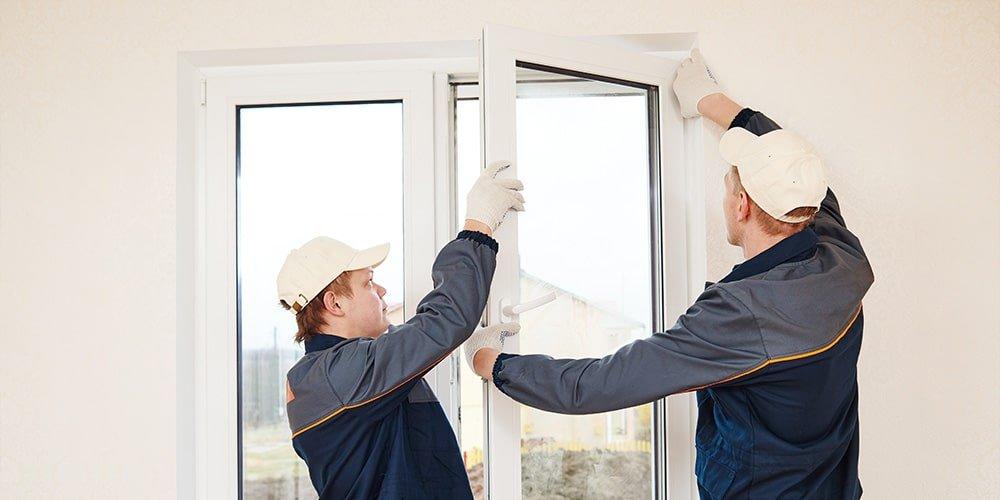 Contractors installing a window