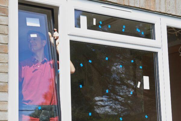 Worker installing windows