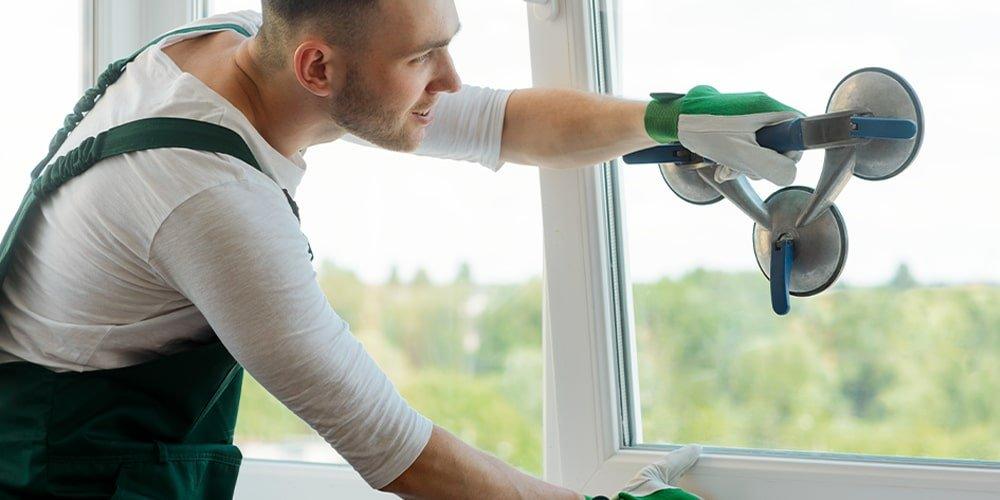 Worker repairing a window-Featured