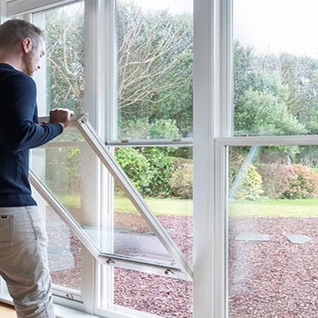 andersen windows man opening a window